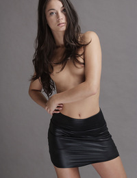 Georgia,Gorgeous,18 year old Georgia sheds her sleek black leather miniskirt and poses nude gazing into the camera with emerald green eyes.