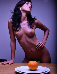 Nella,Orange Crush,In a symphony of light shadow & color Nella squeezes the juice of an orange and lets it drip all over her naked body.