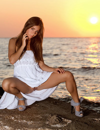 Lily C: Sunsubiro by Luca Helios - With the setting sun as a background, Lily strips off her white beach dress to flaunt her amazingly flexible and at